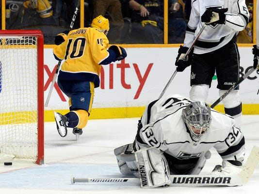 Nashville Predators center Colton Sissons (10) celebrates after scoring a goal against Los Angeles Kings goaltender Jonathan Quick (32) during the second period of an NHL hockey game Thursday, Feb. 1, 2018, in Nashville, Tenn. (AP Photo/Mark Zaleski)