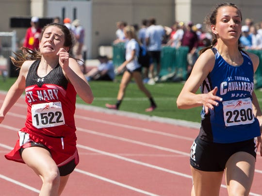 Dell Rapids St. Mary High School Ella Heinitz, left and St. Thomas More Ciara Benson participate in the high school girls 100 prelims during the Howard Wood Dakota Relays on Friday, May 4, 2018, at Howard Wood Field in Sioux Falls.