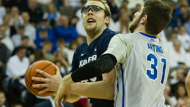 Xavier center Matt Stainbrook drives against Creighton center Will Artino on Saturday at CenturyLink Center Omaha.