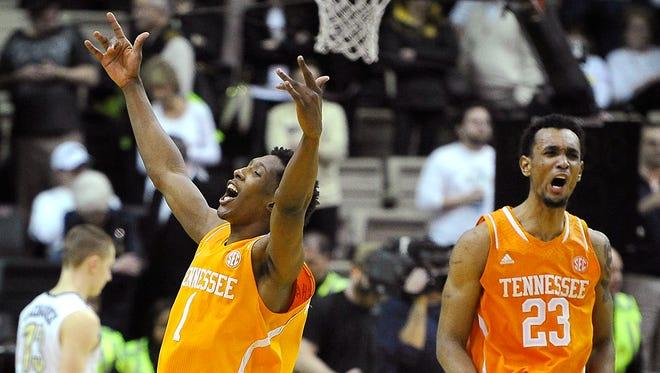 Tennessee's Josh Richardson (1) and Derek Reese (23) celebrate after defeating Vanderbilt 76-73 in overtime Wednesday.