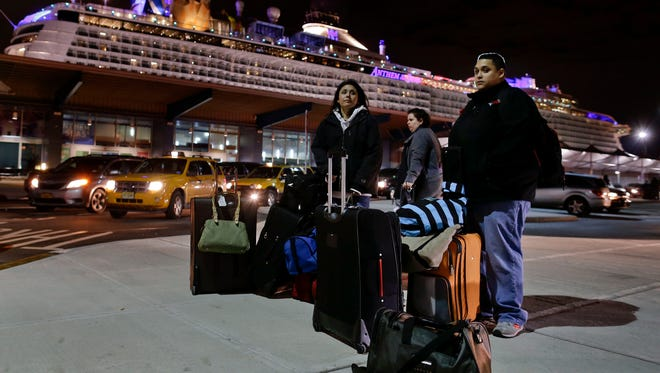 Passengers from the Royal Caribbean cruise ship, Anthem of the Seas, await transportation after arriving at Cape Liberty cruise port, Wednesday, Feb. 10, 2016, in Bayonne, N.J.