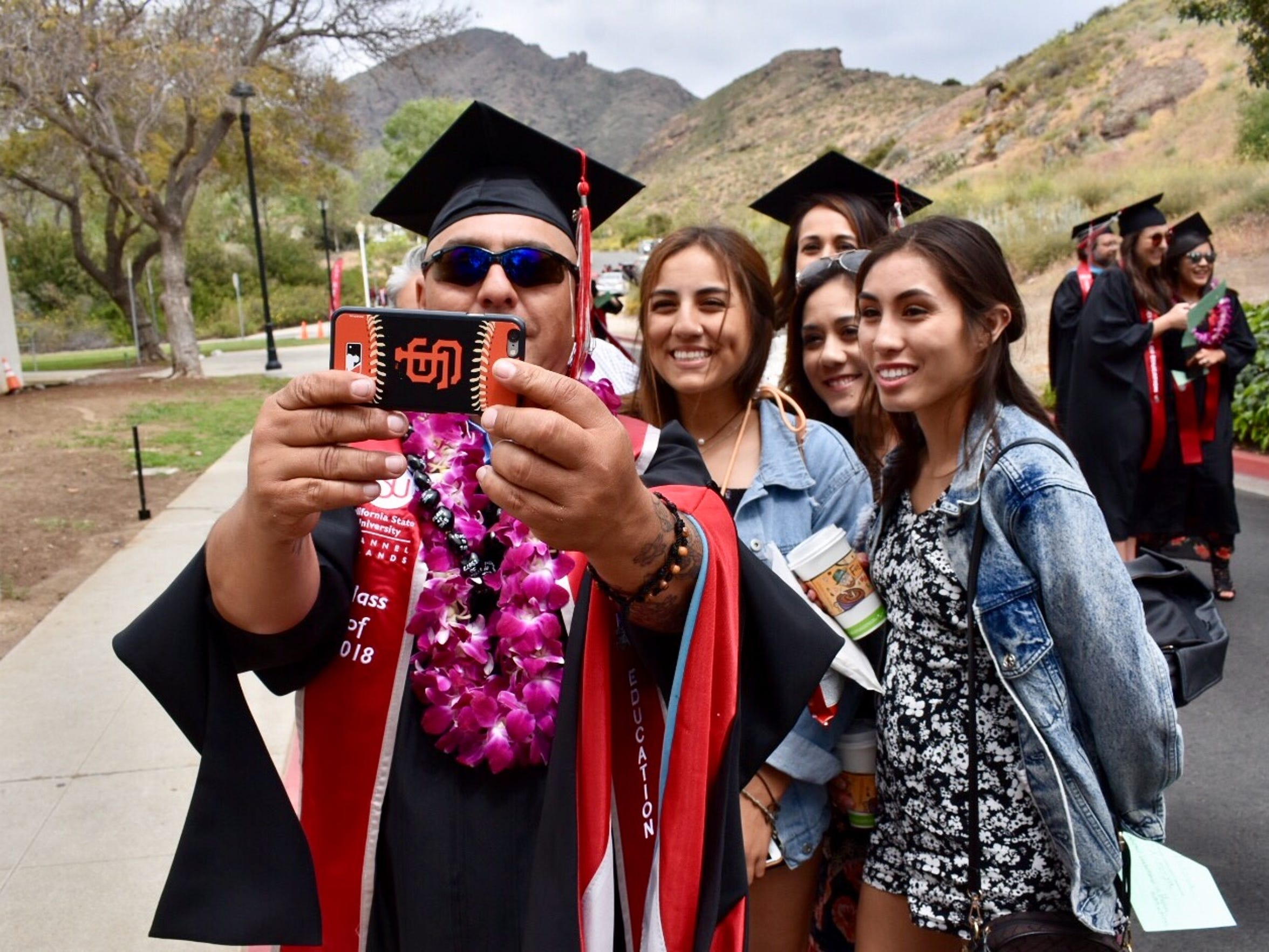 Patrick Tafoya takes a family selfie before graduation.