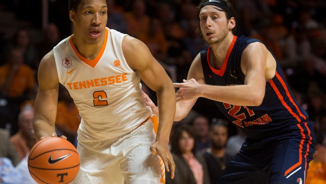 Tennessee forward Grant Williams (2) moves past Carson-Newman guard Mason Bates (21) during Tennessee's home exhibition basketball game against Carson-Newman at Thompson-Boling Arena on Thursday, Nov. 2, 2017.