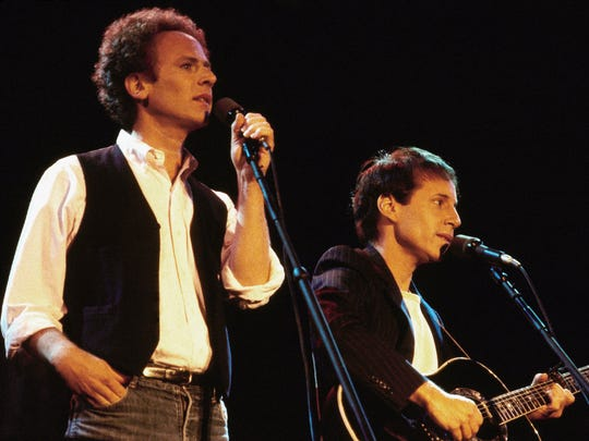 Art Garfunkel, left (wearing vest) and Paul Simon serenade