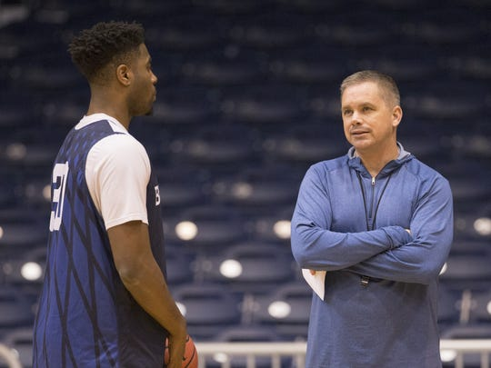 Kelan Martin (left), chats with Chris Holtmann during Butler University men's basketball practice at Hinkle Fieldhouse, Monday. The team faces North Carolina in their Sweet 16 matchup.