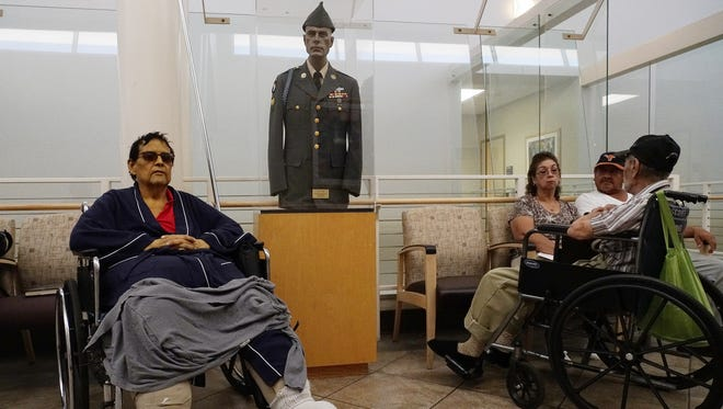 Veterans wait for health-care appointments in the Phoenix VA hospital lobby.