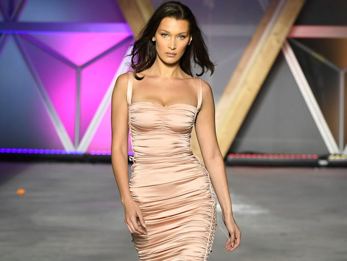 Model Bella Hadid walks the runway at the Fashion For