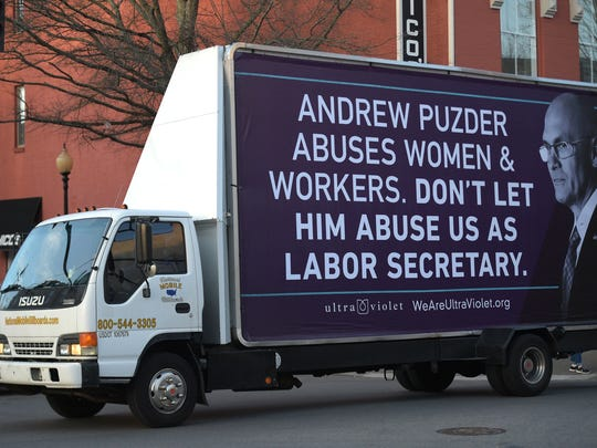 A mobile billboard to drives around downtown Main Street in Franklin, Tenn.  on Tuesday, Jan. 31, 2017. A national women's advocacy group commissioned the billboard in opposition to Trump Labor Secretary nominee Andrew Puzder in his hometown of Franklin.
