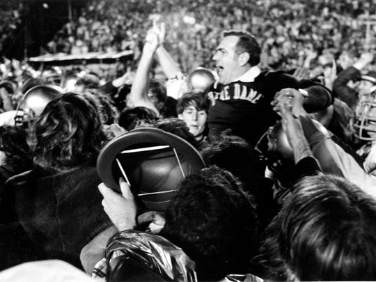 """Notre Dame coach Ara Parseghian is carried off the football field amid shouts of """"we're number one"""" after his Irish beat the undefeated Alabama Crimson Tide, 24-23, at the Sugar Bowl at Tulane Stadium in New Orleans, La."""