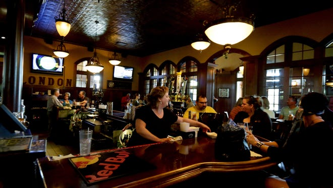 Guests enjoy Happy Hour at Beefeaters British Grille & Ale House in Appleton, Wisconsin. The restaurant offers a free wings and nachos bar Monday through Friday from 3 p.m. to 7 p.m.