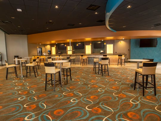 The lobby inside AMC Stones River 9 features high-top tables for moviegoers to enjoy a snack or drink before the show.