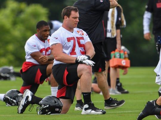 Jun 12, 2019; Flowery Branch, GA, USA; Atlanta Falcons offensive tackle John Wetzel (75) stretches during mini camp at Falcons Training Complex. Mandatory Credit: Dale Zanine-USA TODAY Sports