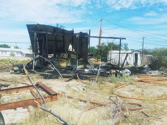 A small fire ignited around 10 a.m. Wednesday morning near Yucca Elementary School destroying a shed and two vehicles.