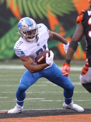 Lions running back Ameer Abdullah runs with the ball against the Bengals during the first half on Sunday, Dec. 24, 2017, in Cincinnati.