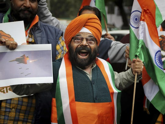A National Akali Dal leader shouts slogans in support of India and against Pakistan as he celebrates reports of Indian aircrafts bombing Pakistan territory, in New Delhi, India, Feb. 26, 2019.
