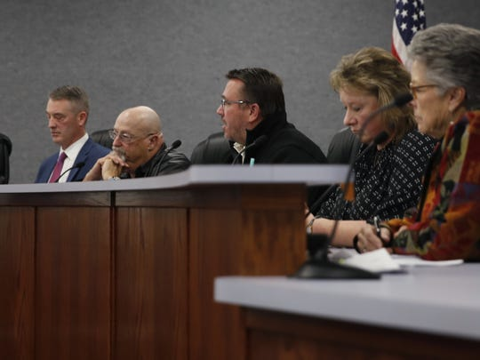 Aztec City Commission candidate Joel Barton, center, answers a question Thursday during a candidate forum at Aztec City Hall. Candidates Victor Snover, Mark Lewis, Sheri Rogers and Rosalyn Fry listen to Barton's response.