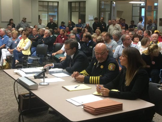 Bellevue Fire Chief Brad Muller sits at a Fire Commission hearing on Tuesday, in which he was cleared of charges made against him by the International Association of Firefighters Local 141.