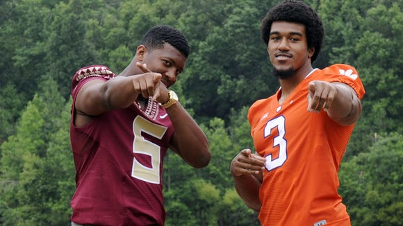 Florida State quarterback Jameis Winston (5) and Clemson defensive end Vic Beasley (3) pose for a photo during the ACC Kickoff.