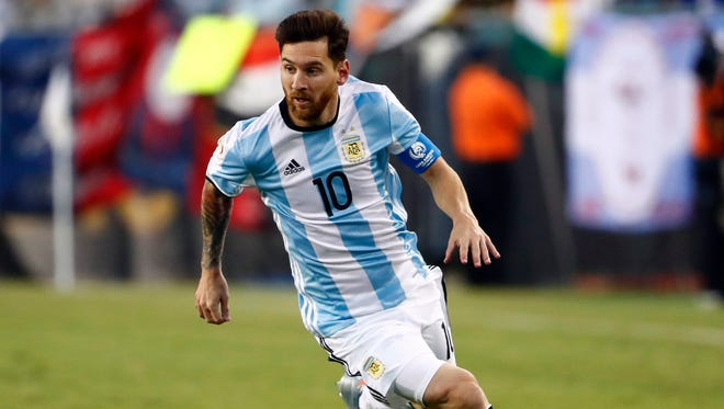 Argentina midfielder Lionel Messi (10) carries the ball during the second half of Argentina's 4-1 win over Venezuela in a quarterfinal match at Copa America.