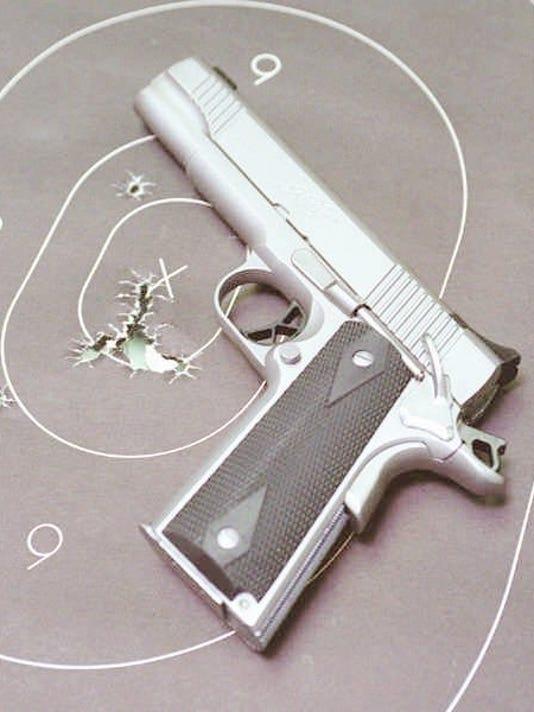 636269188071387629-handgun.jpg