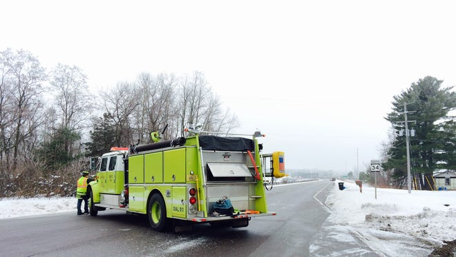 A Mosinee fire truck blocks vehicles from going near the crash scene on the Wisconsin River Bridge on highway 34.