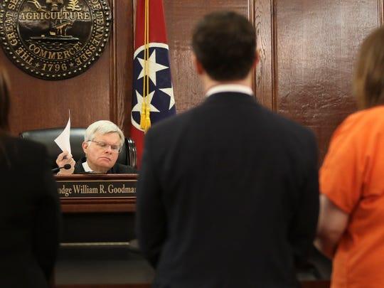Judge William Goodman looks over paperwork as Stefany
