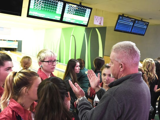 The Elmira girls high school bowling team listens to