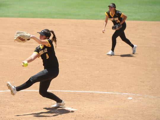Cory Carrillo gets ready to deliver a pitch during Newbury Park's 3-1 win over Riverside-ML King in the CIF-SS Division 2 championship game Saturday in Irvine.