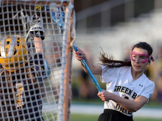 Green Bay United Girls Lacrosse player Paige Wimberly has her shot blocked by the Appleton goalie in the first half at Green Bay Southwest High School on Monday.