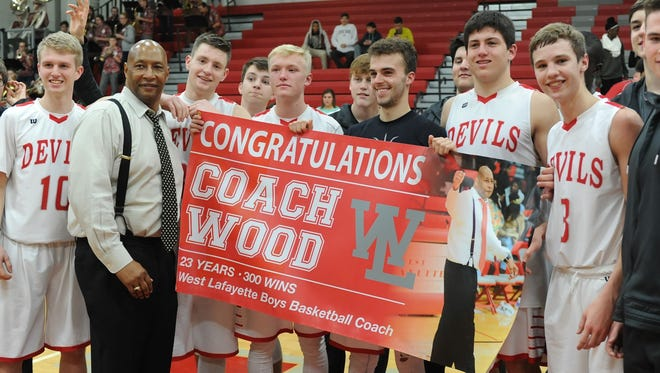 West Side players celebrate Coach David Wood's 300th career victory Tuesday night.
