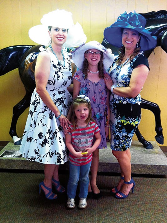 Derby hats brightened the Turf Club Saturday during the Kentucky Derby party held at the Ruidoso Downs Race Track and Casino.
