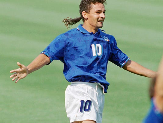 FILE - In this July 13, 1994 file photo, Italy's Roberto Baggio celebrates after scoring during the semifinal World Cup soccer match, Italy vs. Bulgaria at Giants Stadium, East Rutherford, N.J. Legendary Italian striker Roberto Baggio marked his 50th birthday on Saturday, Feb. 18, 2017 by visiting towns devastated by a series of earthquakes last year. Baggio, who is regarded as one of the best ever players, opted not to celebrate surrounded by celebrities but instead spent the day in Amatrice, which was almost wiped out by the Aug. 24 earthquake. (AP Photo/Michael Probst/File)