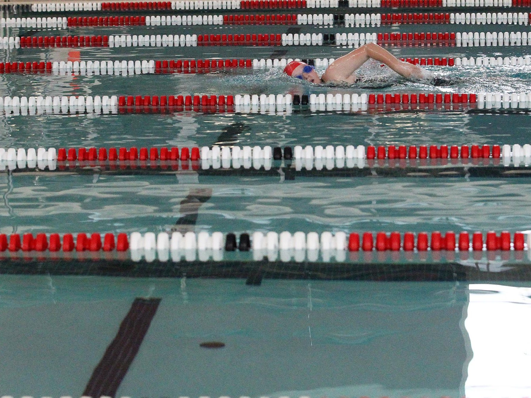 Kory Ulrich practices her freestyle stroke during Coldwater's mock meet on Sunday.
