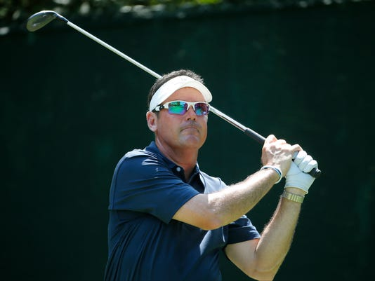 In this photo taken July 28, 2016 Rich Beem watches his tee shot on the 16th hole during the first round of the PGA Championship golf tournament at Baltusrol Golf Club in Springfield, N.J. Beem, the 2002 PGA champion, is a TV analyst for Sky Sports and the PGA is the only event he played this year. (AP Photo/Mike Groll)