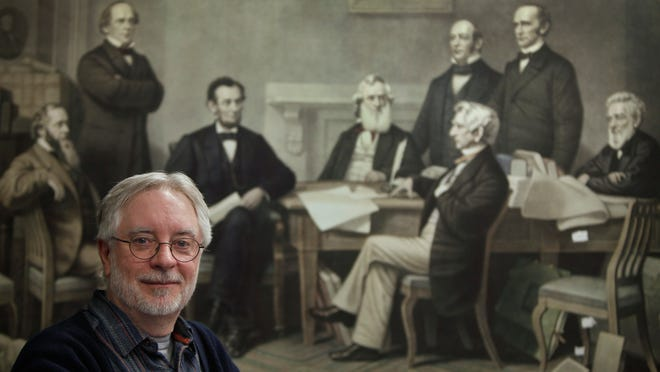 University of Rochester history professor Thomas P. Slaughter poses in front of a print of the signing of the Emancipation Proclamation in the Digital Humanities Center at Rush Rhees Library. Slaughter is shepherding The Seward Family Project, which takes some of the massive collection of letters, diaries and other documents housed at the university concerning William Henry Seward and his family and is putting them into a digital format for online display. Seward, who was Lincoln's Secretary of State, is seated at center right in the print.