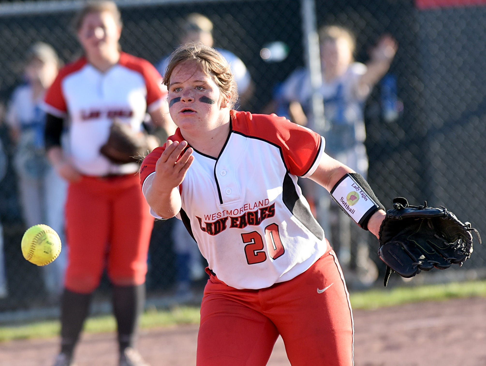 Westmoreland High senior pitcher Tiffany Wheeley flips to first base for a fifth-inning putout.