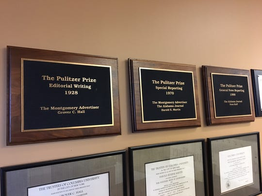 Three Pulitzer Prize plaques hang on the wall of the Montgomery Advertiser newsroom.