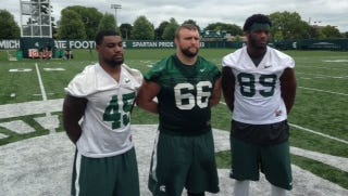 Michigan State football captains, from left, Darien Harris, Jack Allen and Shilique Calhoun.