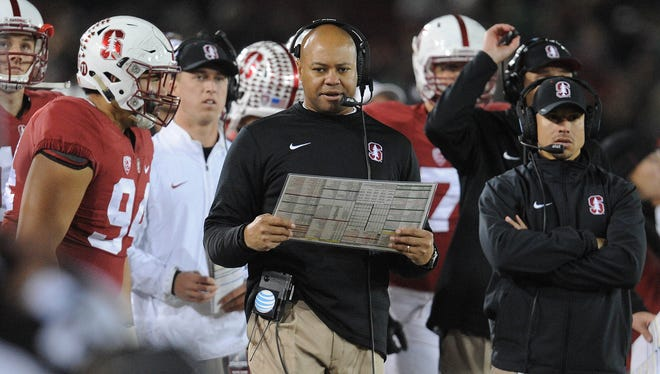 Stanford coach David Shaw (center) sees practice contact as instilling a mindset and toughness that is key to his team.