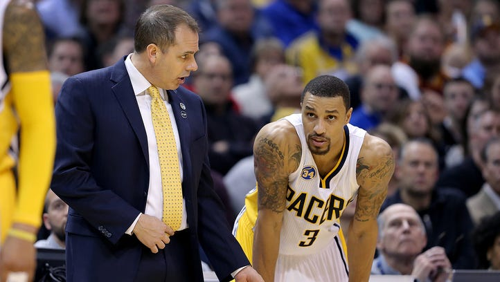 Indiana Pacers head coach Frank Vogel talks with George Hill (3) in the second half of their game Monday, Feb 1, 2016, evening at Bankers Life Fieldhouse. The Indiana Pacers lost to the Cleveland Cavaliers 106-111.
