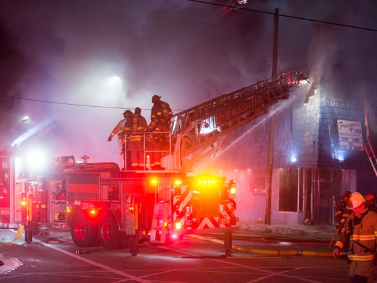 Emergency responders work to extinguish the fire that