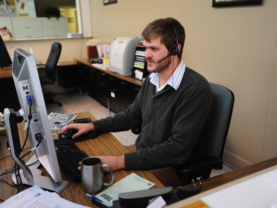 Chris Roy of 232-HELP answers phone calls and gives