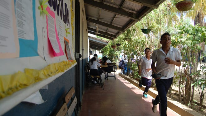 Students run outside a school in Leon, Nicaragua, which has an alarming rate of teen suicide.