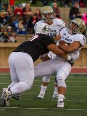 Southern Utah defensive lineman Anu Poleo (90) makes