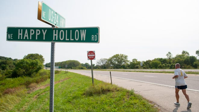 Peter Halper runs past N.E. Happy Hollow Road on US-24 highway Wednesday morning on his quest to run coast to coast to raise money to beat pediatric cancer. His run this week honors 6-year-old Nathan Tuder and 22-month-old Gabrielle Goodwin, each of whom have been diagnosed with neuroblastoma.