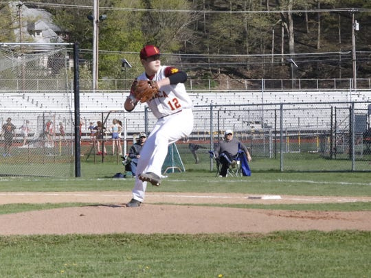 Ithaca pitcher Ronnie Lower delivers a pitch against Elmira on Monday, April 24. Ithaca won, 18-1.