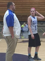 Merrill senior point guard Emily Page talks to Bluejays coach Ross Reincke during a drill at practice.