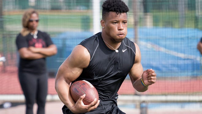 Former Penn State running back Saquon Barkley working out in Walt Disney World leading up to this week's NFL Combine.