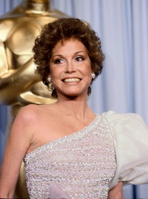 """FILE - This March 31, 1981 file photo shows Mary Tyler Moore at the 53rd Academy Awards in Los Angeles. Moore, nominated for Best Actress for her film """"Ordinary People,"""" lost out to Sissy Spacek for """"Coal Miner's Daughter.""""  Moore died Wednesday, Jan. 25, 2017, at age 80. (AP Photo/Randy Rasmussen, File) ORG XMIT: NYET333"""