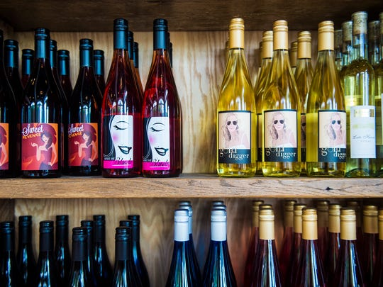 Bottles of wine line the shelves at Knob Hall Winery in Gettysburg on July 3, 2016.